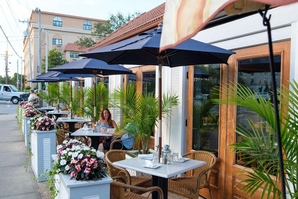 Patrons dine on the outdoor patio of Lola's