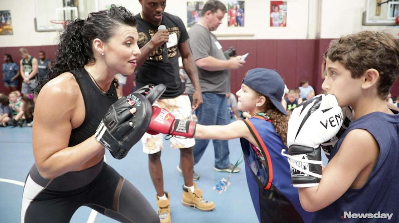 Fighters Peter Quillin and Alicia Napoleon met with