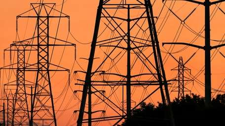 Energy Budget. Transmission towers carry power lines through