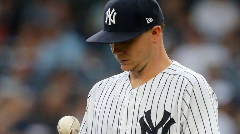 Yankees pitcher Sonny Gray reacts on the mound
