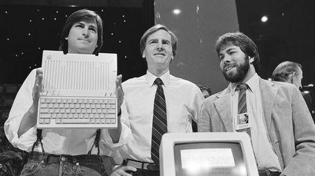 Steve Jobs, left, chairman of Apple Computers, John