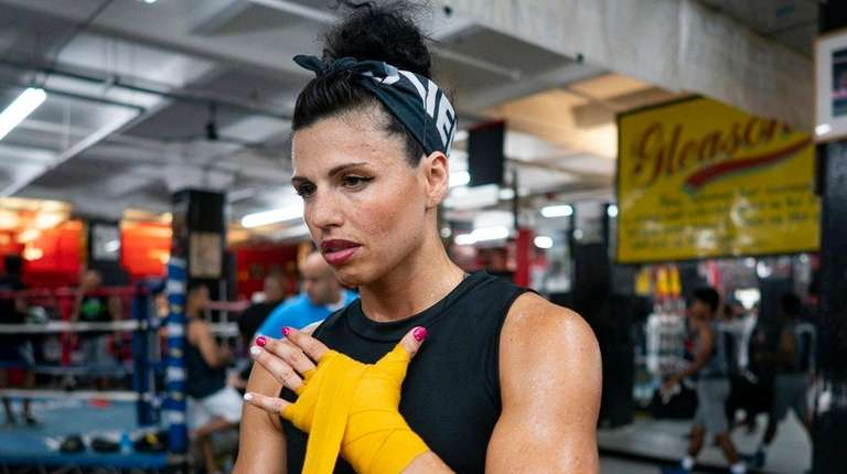 Alicia Napoleon wraps her hands before a workout