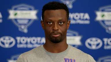 Giants cornerback Eli Apple talks to the media