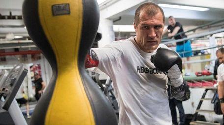 Sergey Kovalev hits a punching bag during a