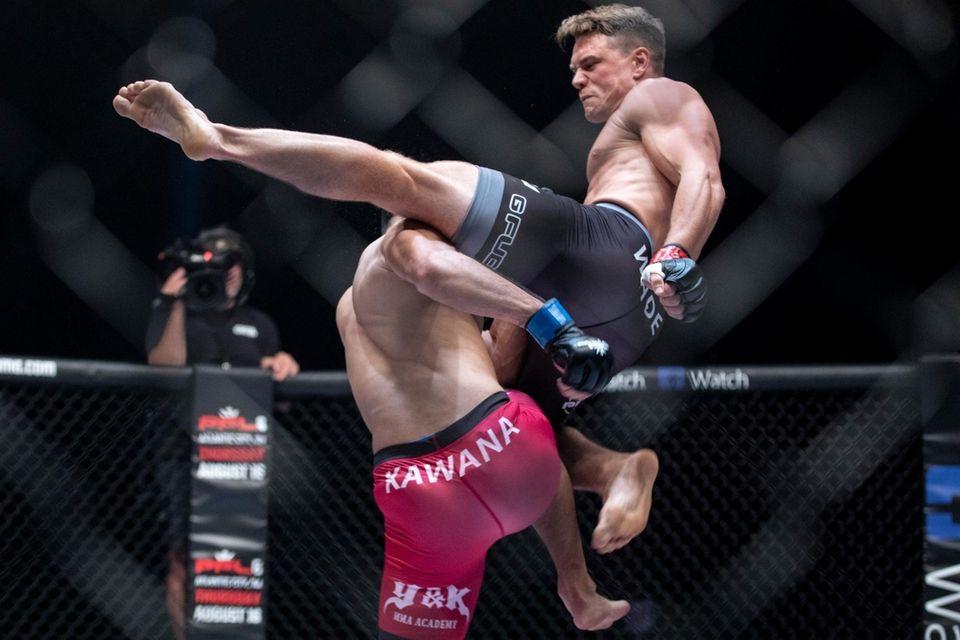 Islip's Chris Wade, right, kicks Yuki Kawana during