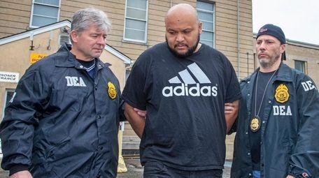Miguel Angel Corea Diaz leaves Nassau police headquarters