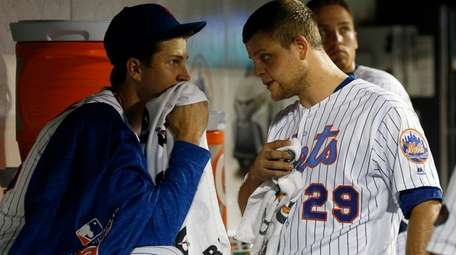 Jacob deGrom and Devin Mesoraco of the Mets