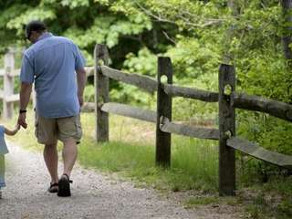Peter Walsh and his daughter Molly, 3, walk