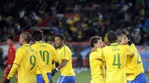Brazil's Maicon, right, is congratulated by teammate Elano