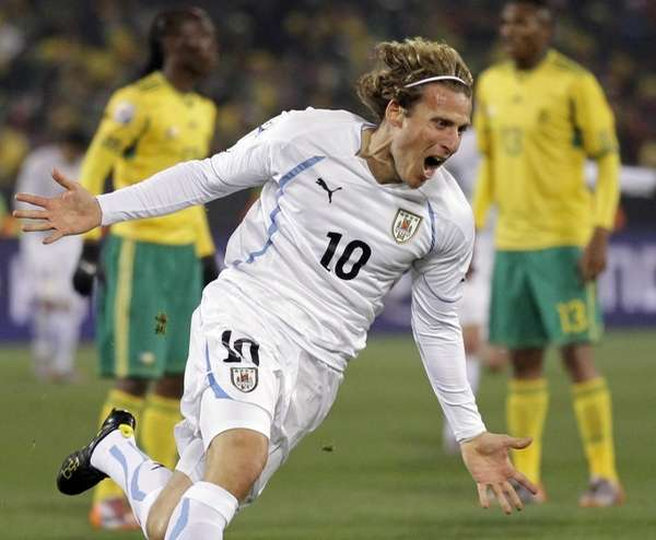 Uruguay's Diego Forlan celebrates after scoring against South