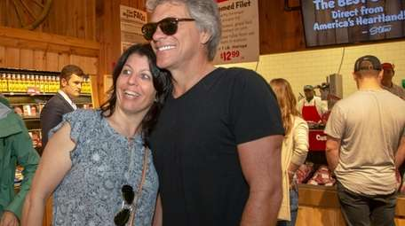 Singer Jon Bon Jovi, poses with shopper Gereese