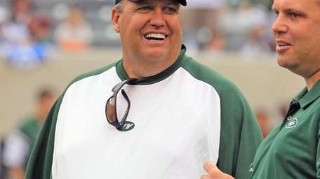 Jets head coach Rex Ryan smiles on the
