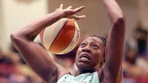 Liberty's Tina Charles gets fouled during women's basketball
