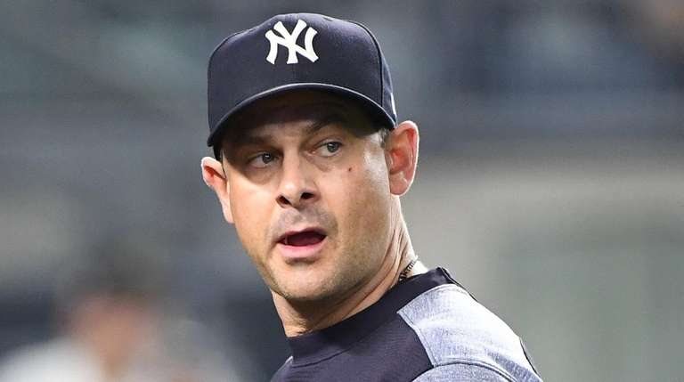 New York Yankees manager Aaron Boone looks up