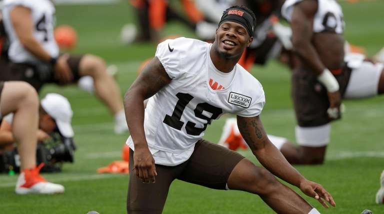 Browns wide receiver Corey Coleman stretches during training