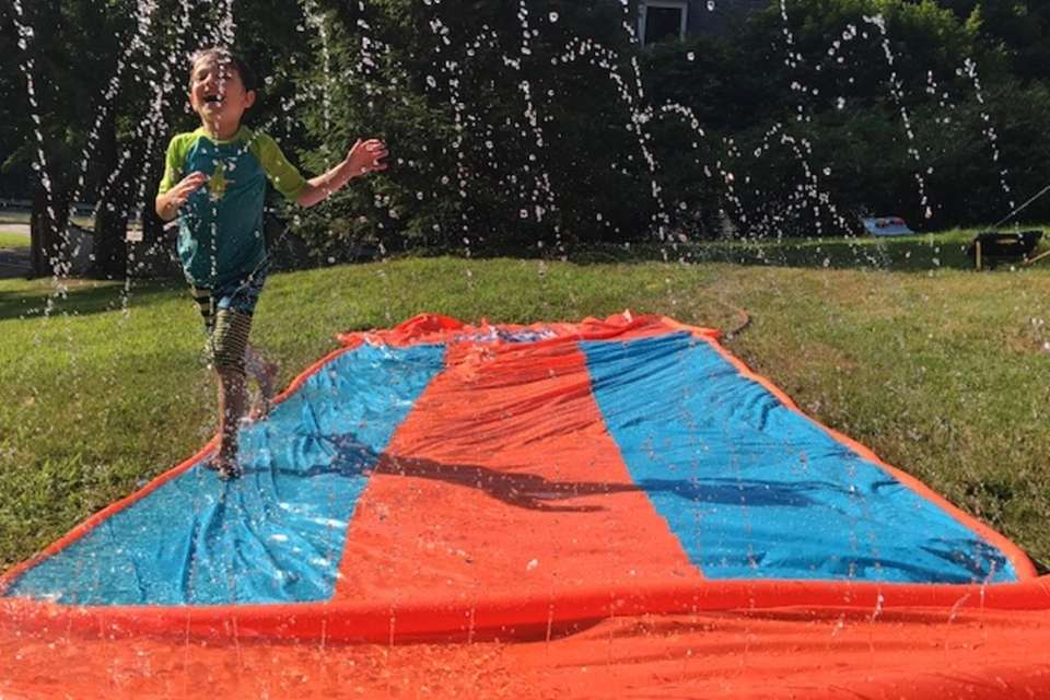 Alex playing on the slip n' slide on