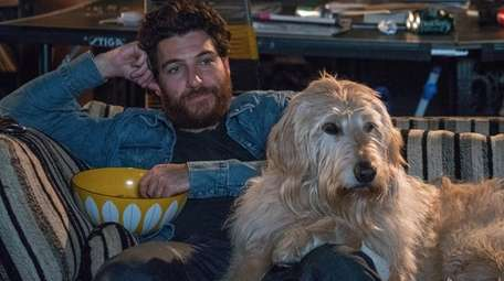 Adam Pally plays rock musician Dax with pooch