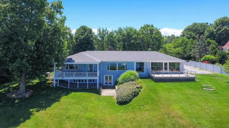 This Setauket ranch, built in 1956, sits on