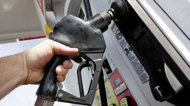 Gas being pumped at a filling station.