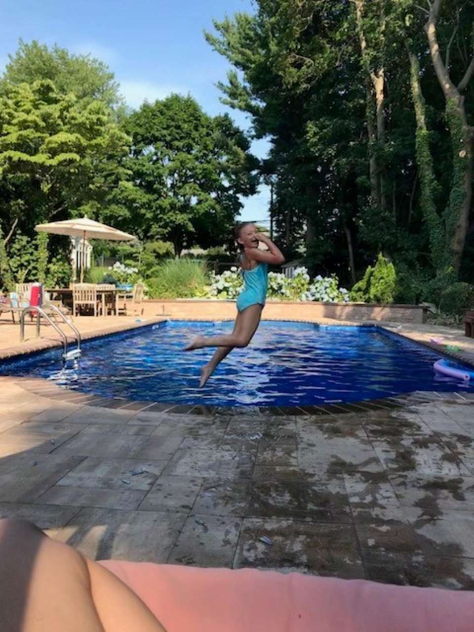 Gianna jumping in the pool