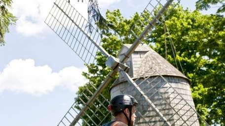 John Newtown rides his bike near the Gardiner