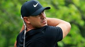 Brooks Koepka plays his shot from the second