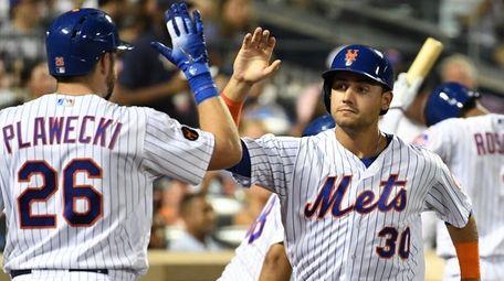 Mets catcher Kevin Plawecki greets Mets leftfielder Michael