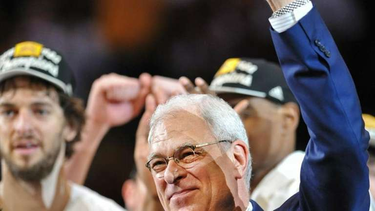 Los Angeles Lakers coach Phil Jackson acknowledges the