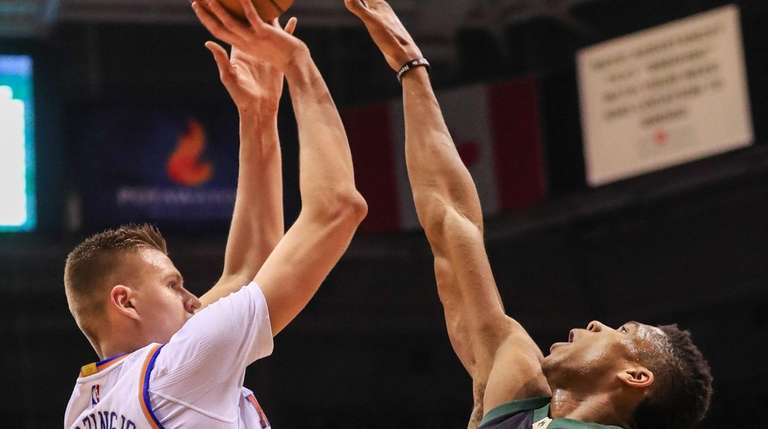 Knicks forward Kristaps Porzingis  shoots over Milwaukee