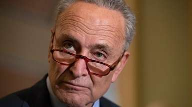 Senate Minority Leader Chuck Schumer speaks with reporters
