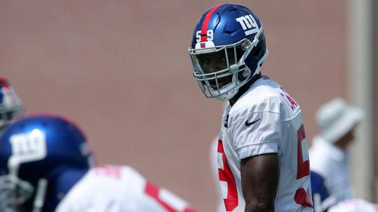 Giants linebacker Lorenzo Carter  lines up during