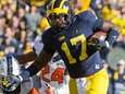 Michigan tight end Tyrone Wheatley pushes away Illinois