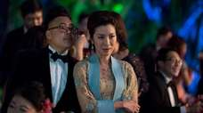 """Nico Santos and Michelle Yeoh in """"Crazy Rich"""