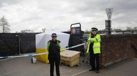 Police officers guard a cordon near the spot