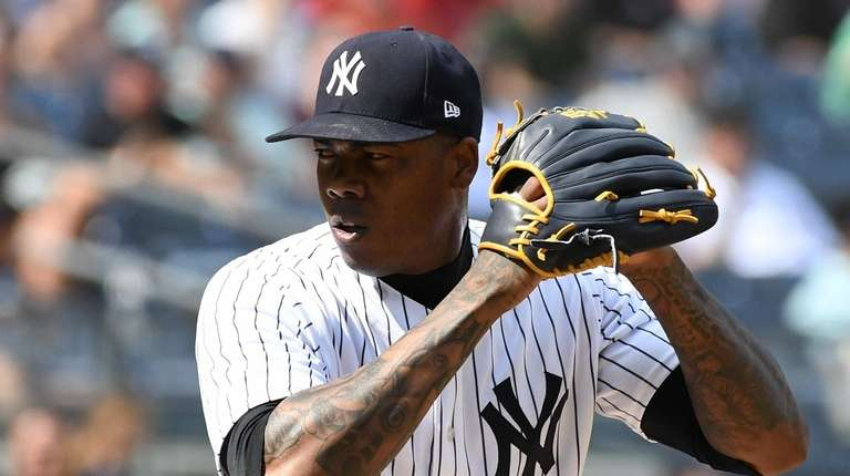 Yankees relief pitcher Aroldis Chapman delivers a pitch