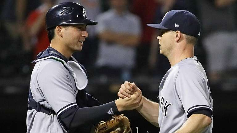 Kyle Higashioka, left, and Sonny Gray of the