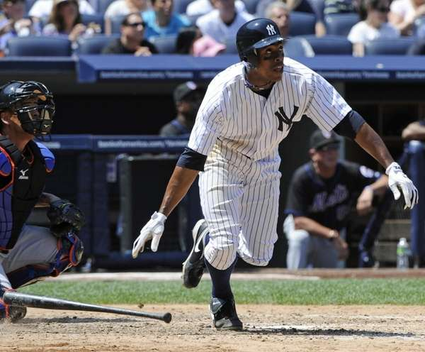New York Yankees' Curtis Granderson watches his two-run