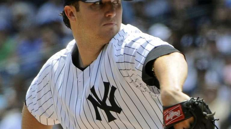 Yankees pitcher Phil Hughes delivers the ball to