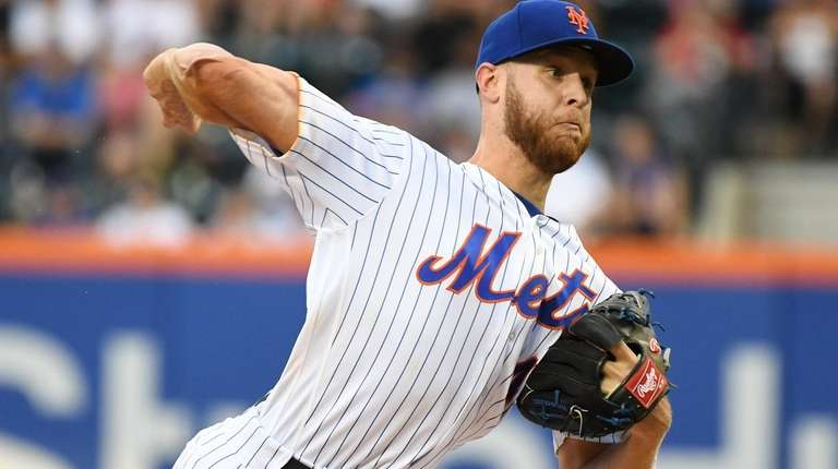 New York Mets starting pitcher Zack Wheeler delivers