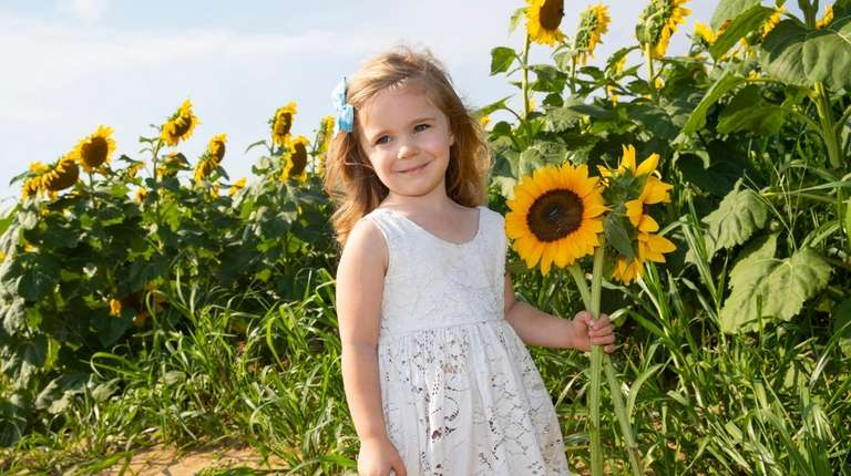 Charlotte Carey, 3, of Wading River visits the