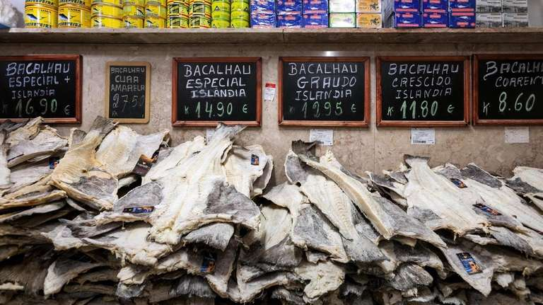 Slabs of dried, salted codfish stacked at a