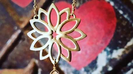 This lotus leaf pendant is on a gold-filled