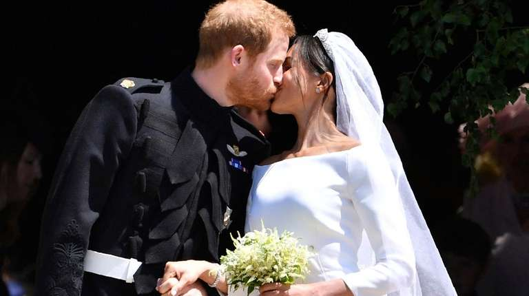 Britain's Prince Harry and his wife, Meghan Markle,