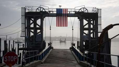 The Hart Island ferry arrives at City Island