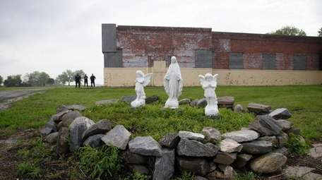 Statues on display near the ferry dock on