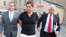 Robert Savinetti leaves Nassau Police headquarters on Wednesday,