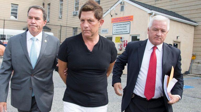 Robert Savinetti leaves Nassau police headquarters in Mineola