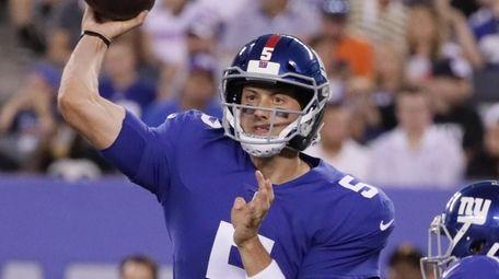 Giants quarterback Davis Webb throws a pass during