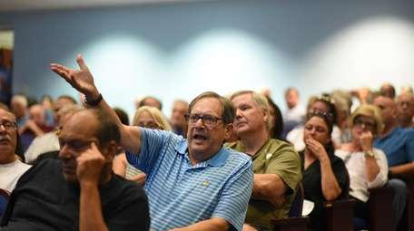 Alan Dorman of Hewlett Harbor reacts during a