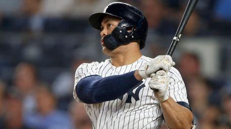 The Yankees' Giancarlo Stanton follows through on a